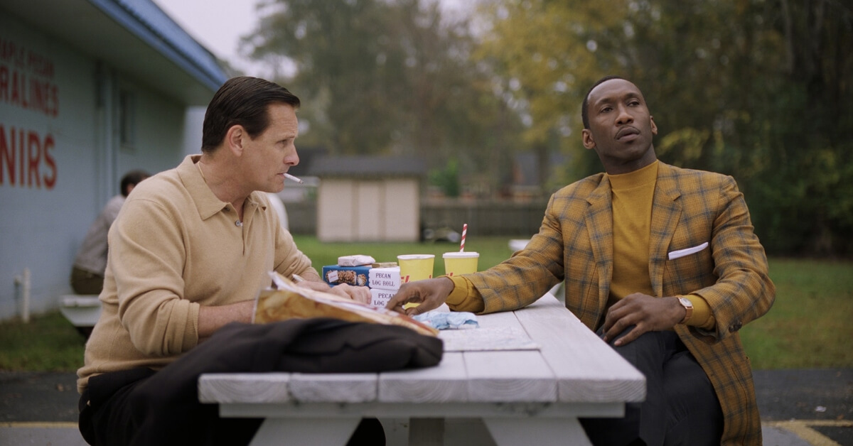 Dr Don Shirley helping Tony Lip write a letter to his wife in Green Book.
