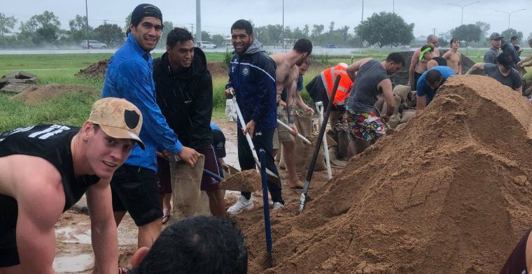 Local residents and members of the Cowboys NRL team helped on Saturday with sandbagging and building levy walls.