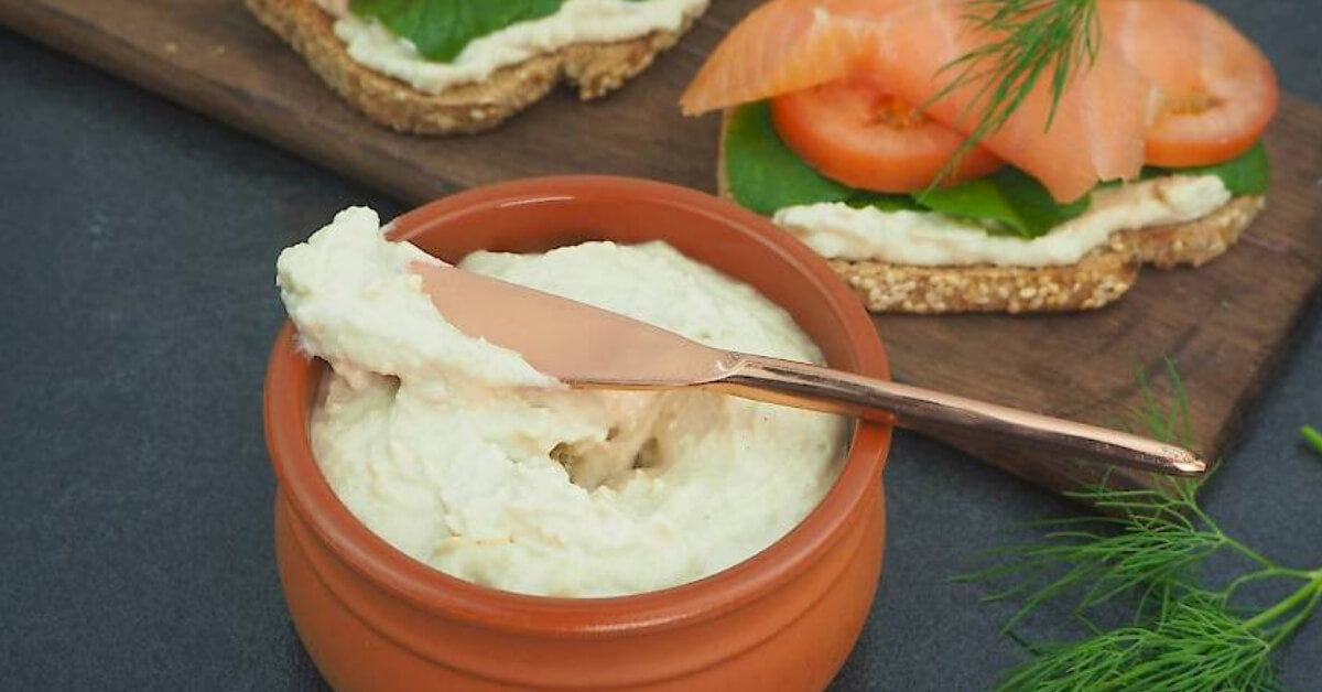nut cheese spread in a pot beside crackers
