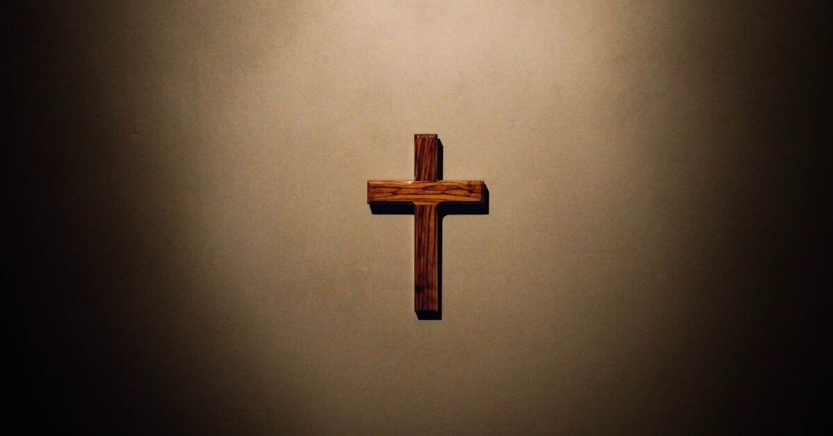 a cross on a brown background