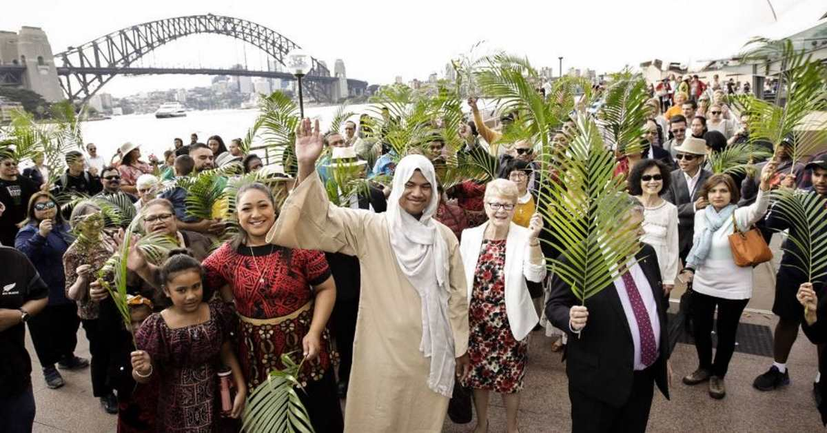 Members of Wesley Mission Church in Sydney – including William Lemalu dressed as Jesus – celebrate Palm Sunday in Circular Quay