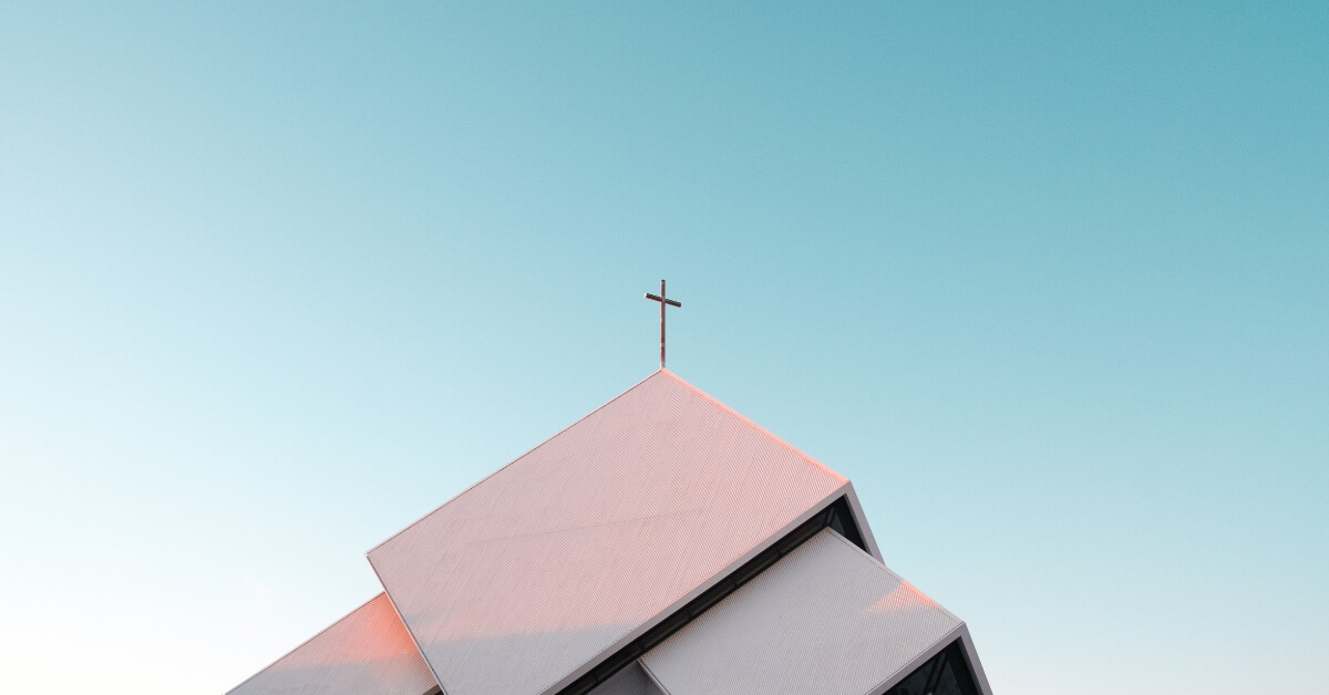 a cross on a church roof