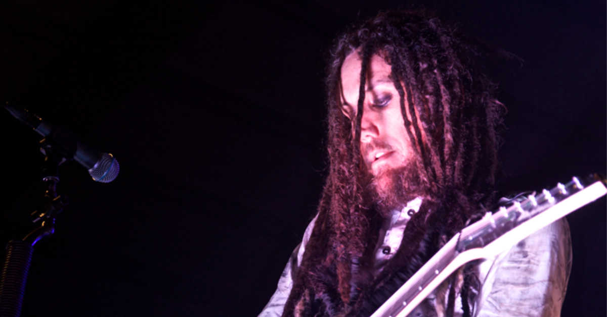 Brian Welch playing guitar on stage