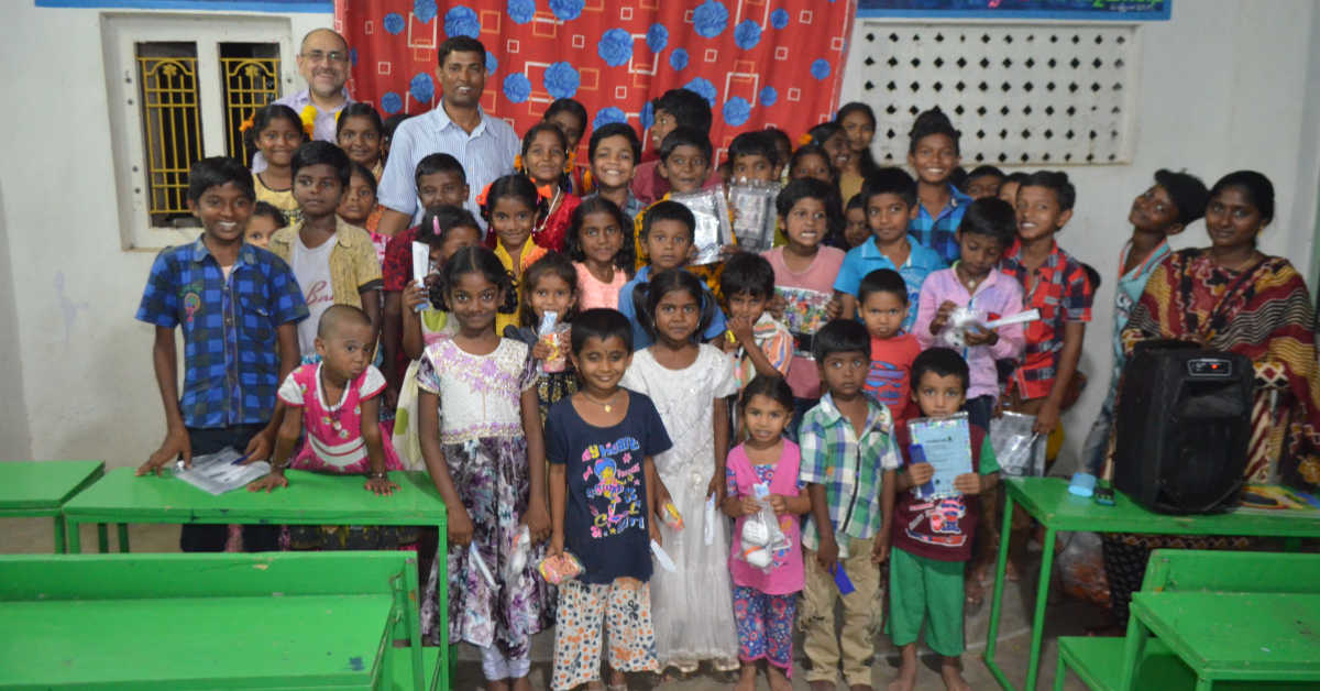 Children holding up their gifts at the good news centre