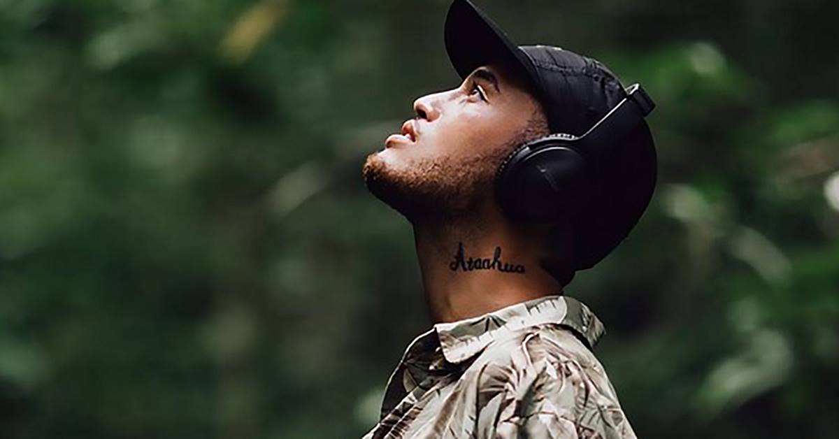Stan Walker Wearing headphones looking upwards