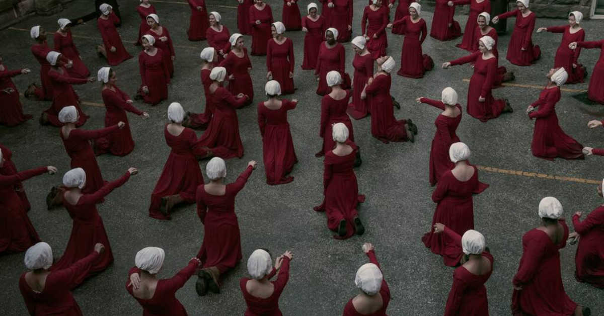 The handmaids of 'The Hand Maids' tale in a cirle