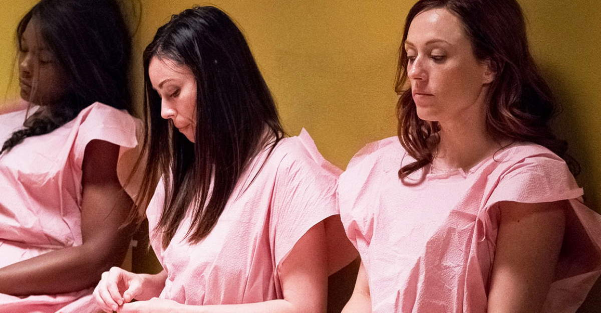 Women waiting in room wearing medical gowns - scene from Unplanned Movie