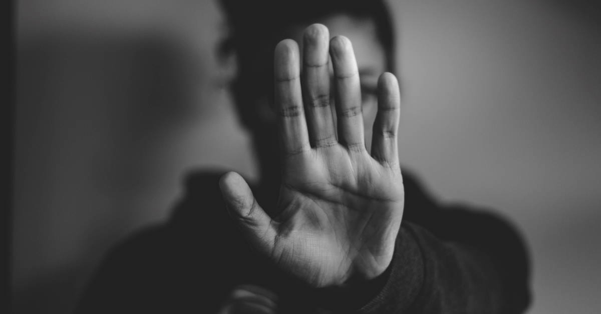 close-up black and white photo of person lifting hands