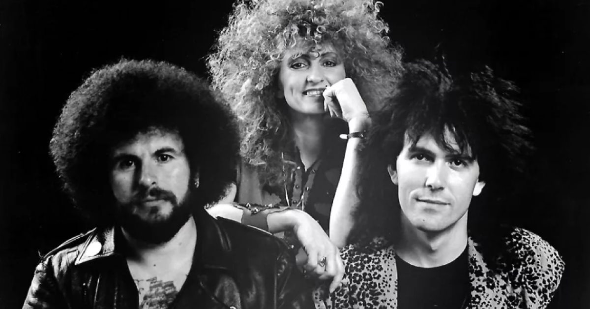 black and white photo of Rosanna's Raiders with big hair circa 1980s
