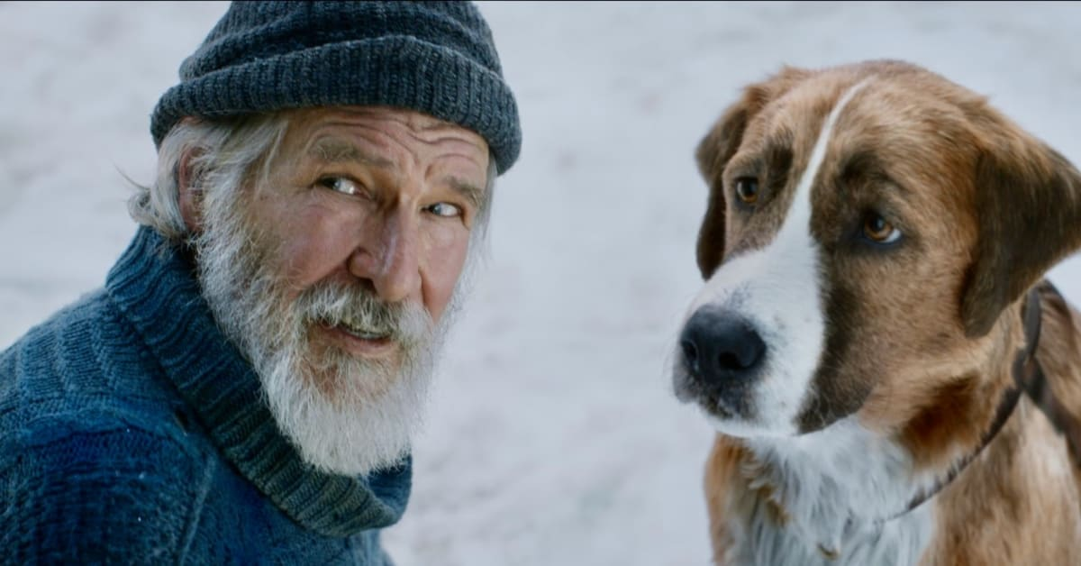 screen shot from film of Harrison Ford and dog in the snow