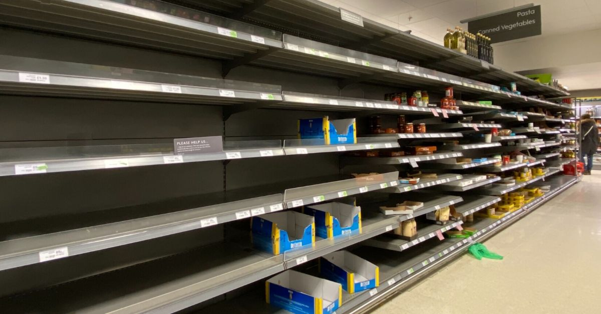 photo of empty supermarket shelves due to coronavirus panic buying