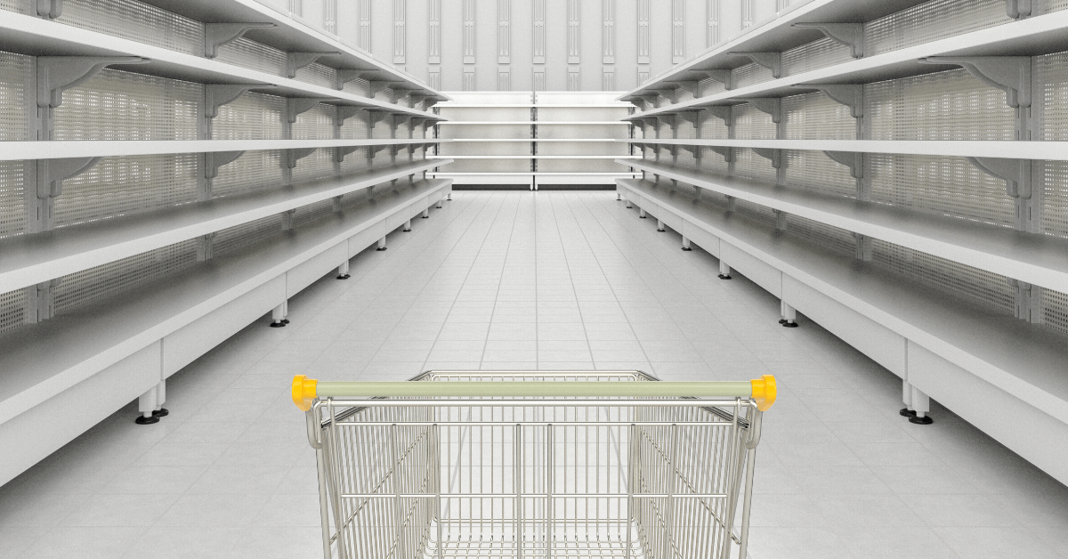 trolley point of view looking out at empty shelves in a supermarket, coronavirus
