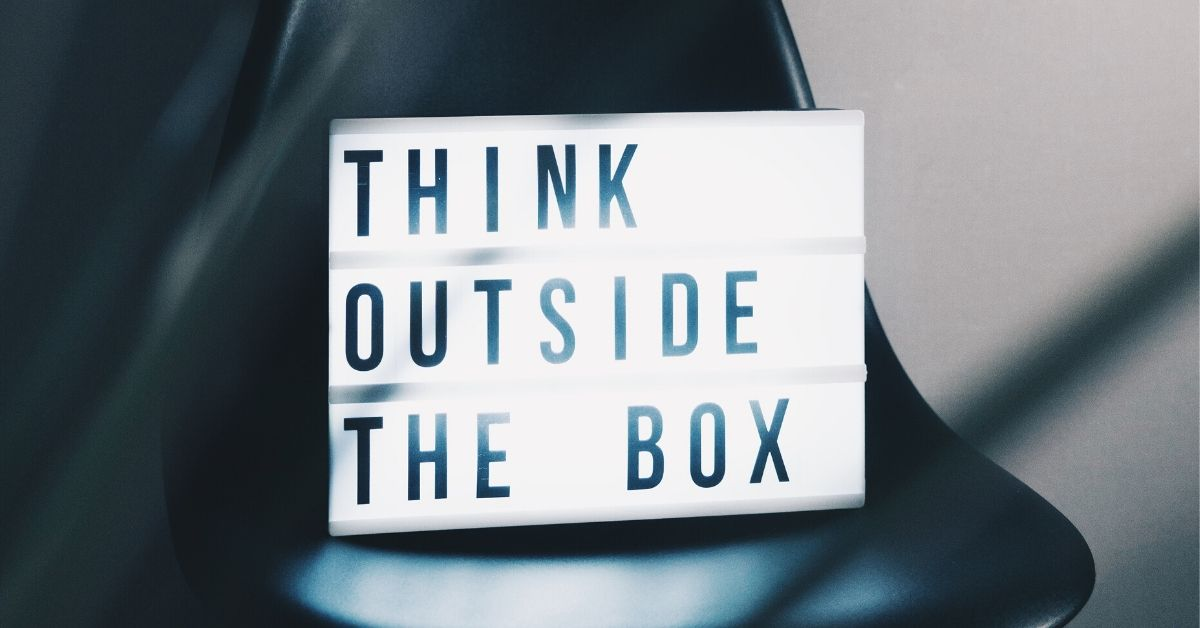 "photo of a lightbox which reads ""think outside the box"""