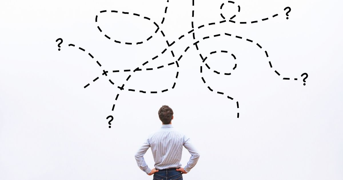 image of a man pondering an illustration of different options leading to question marks