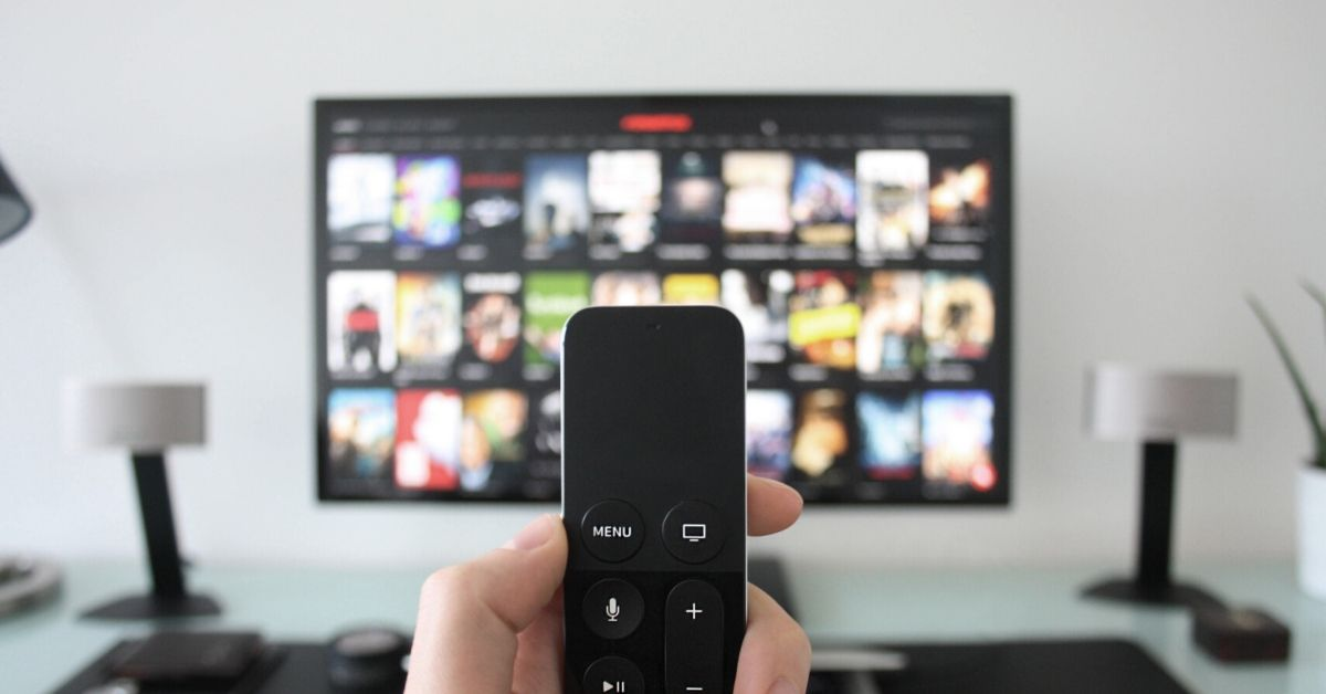 photo of a t remote in front of a tv
