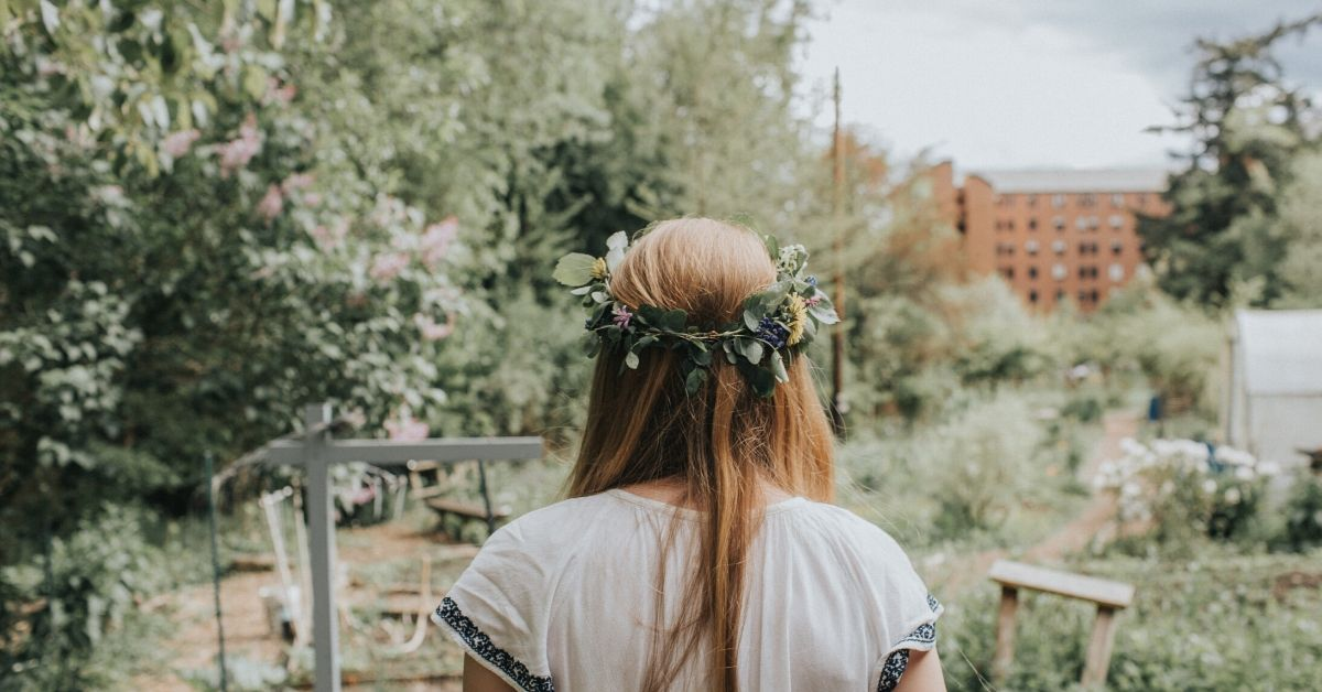 photo of the back of a girl wearing a flower crown