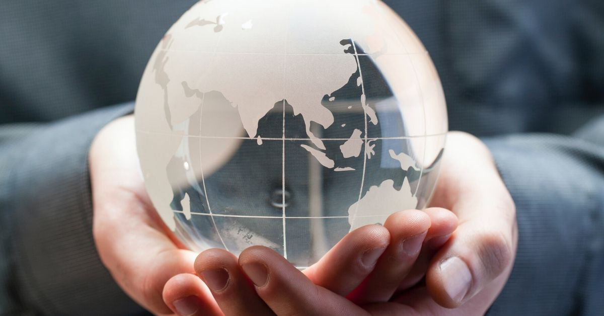 photo of a person holding a glass globe in their hands