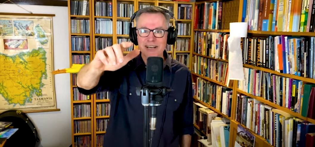 photo depicts colin buchanan singing in the blessing australia video