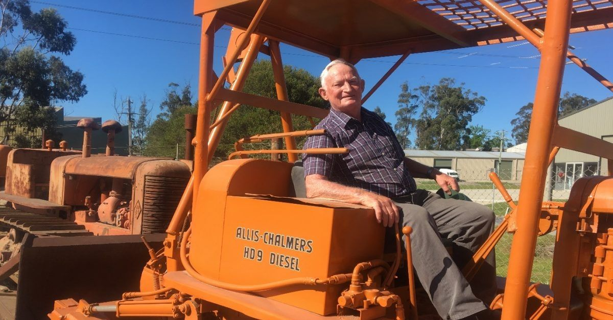 photo of george oscar ronalds on a tractor