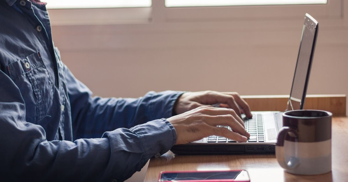 man working on laptop from home making him eligible for a tax claim