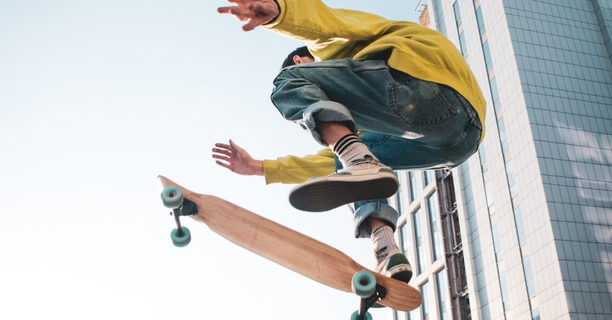 photo of a boy doing a jump on a skateboard