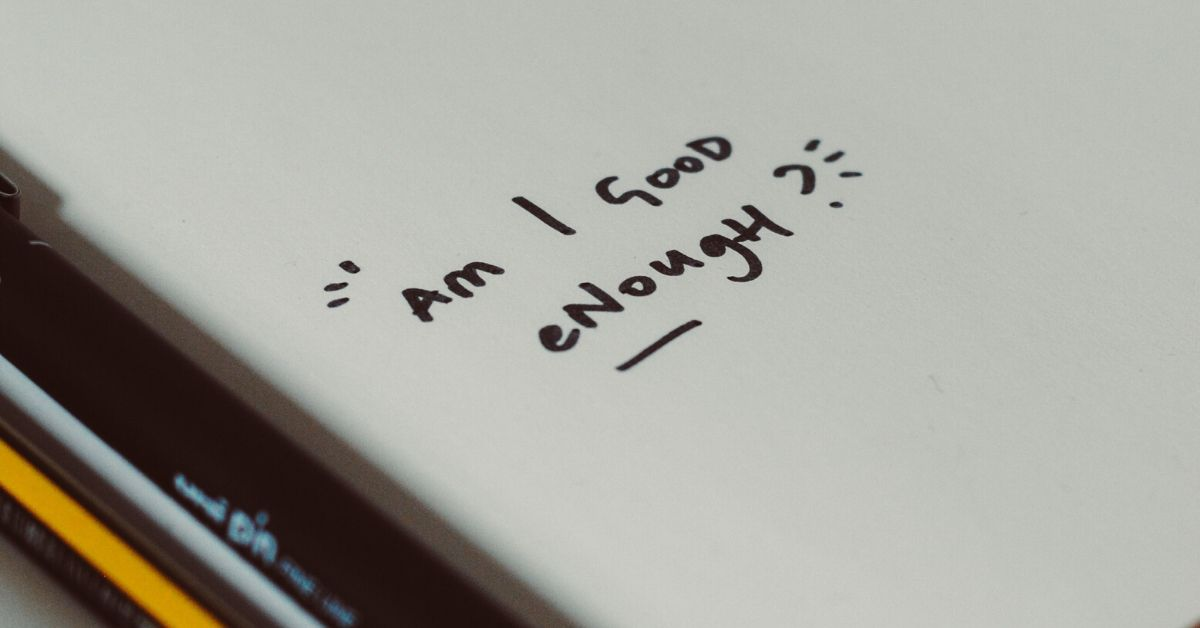 handwritten text which says am i good enough?