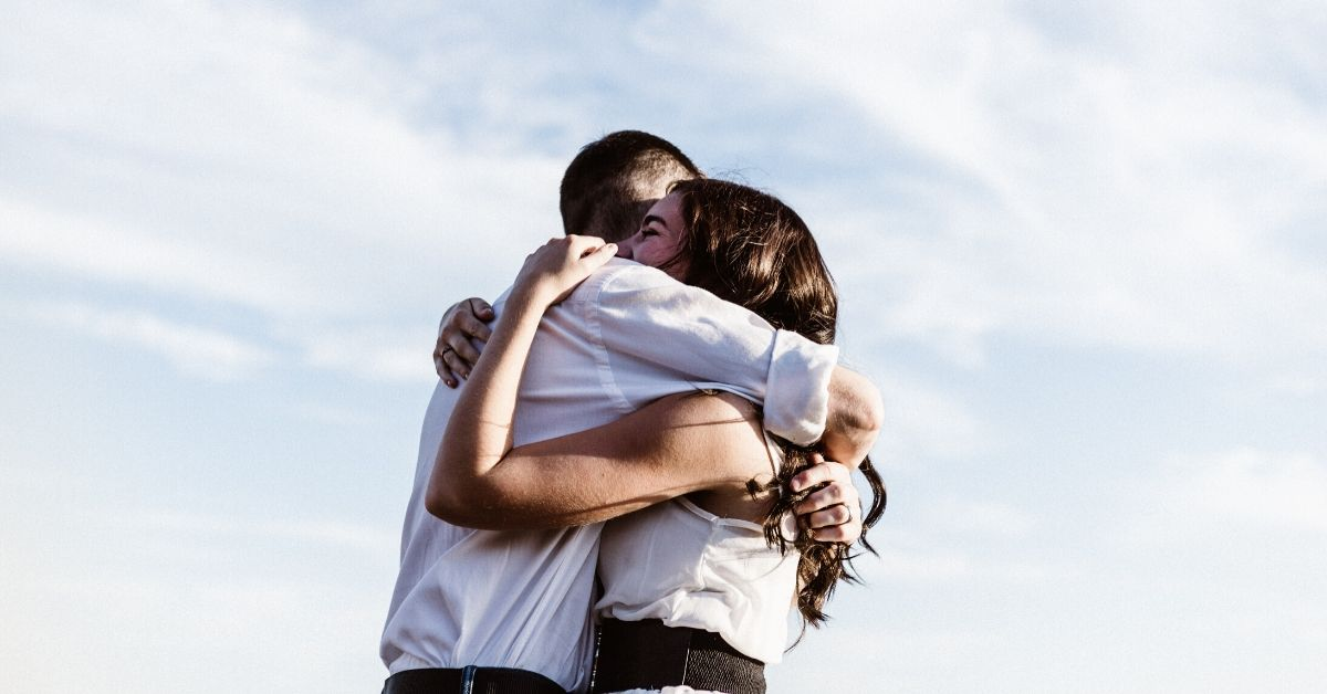 photo of man and woman in a strong embrace