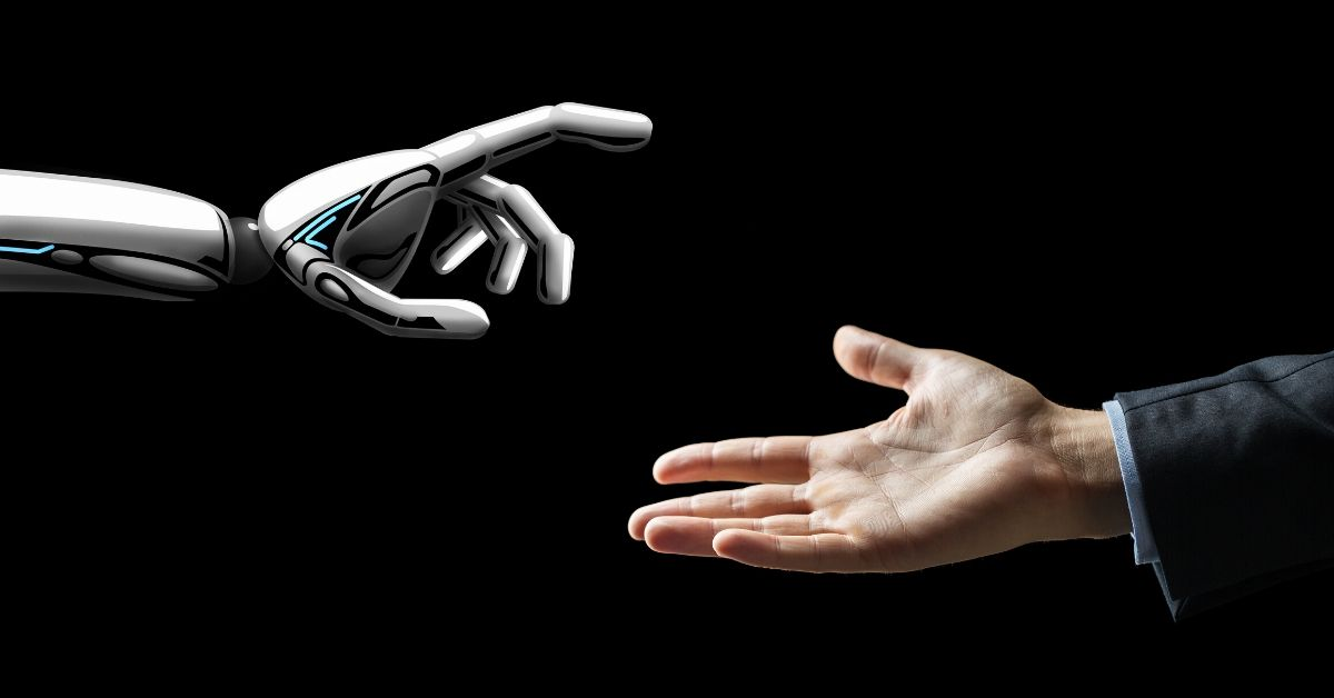 robot hand reaching out to a human hand