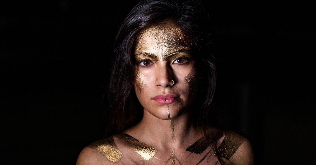 woman with wonder woman inspired face paint