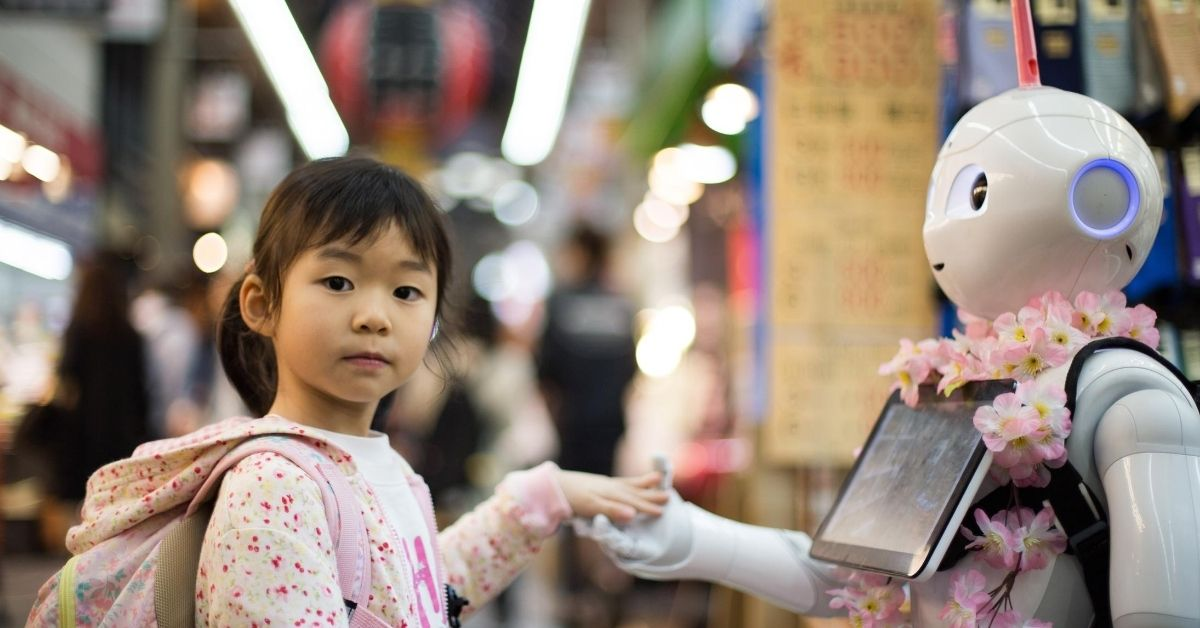 girl holding robot's hand on a street