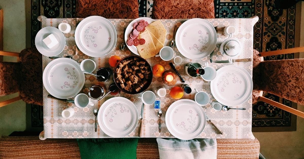 a dining table with plates laid out