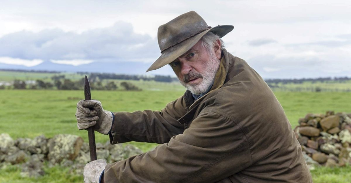 Sam Neill in-character as 'C