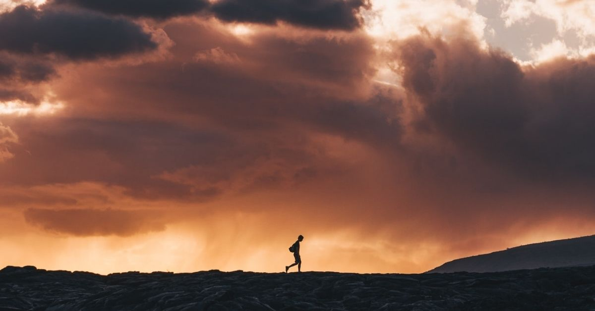 silhouette of a man walking alone