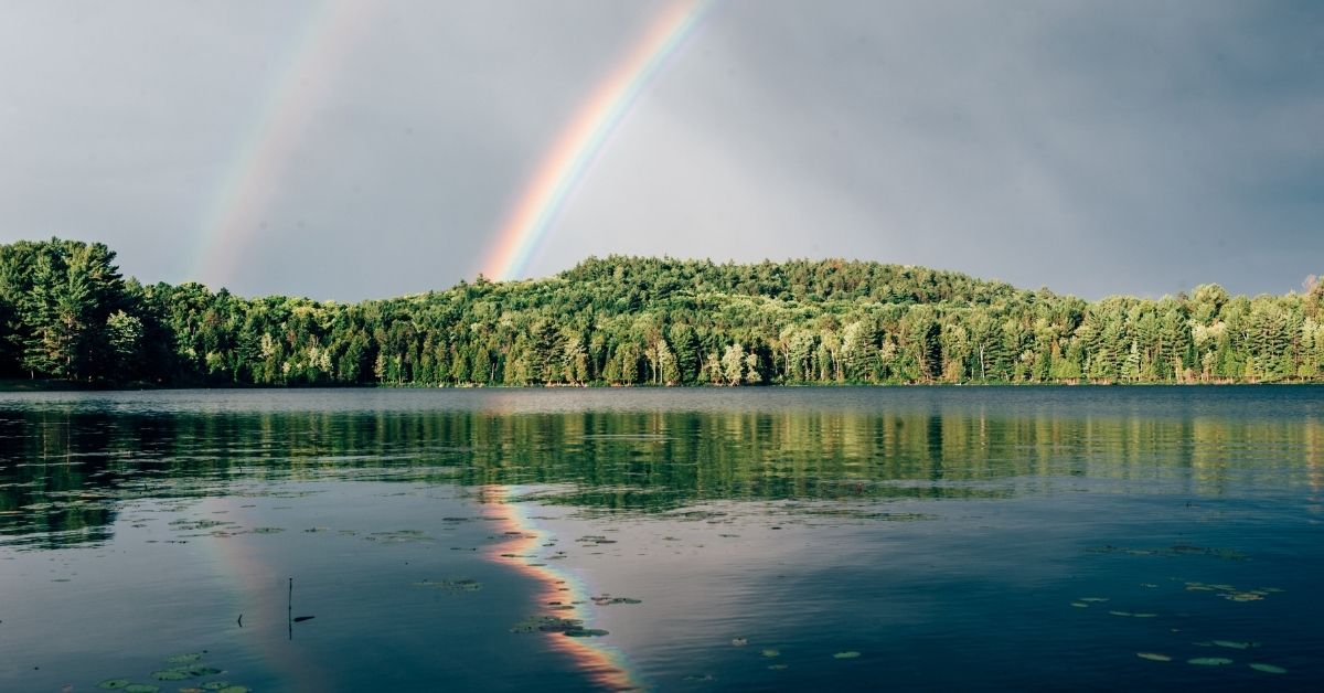 rainbow over still water