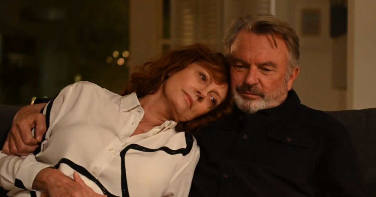 Lily played by Susan Sarandon rests her head on Paul's shoulder (played by Sam Neill)