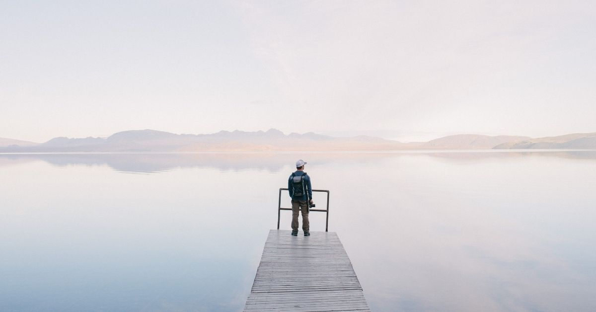 person waiting on a jetty
