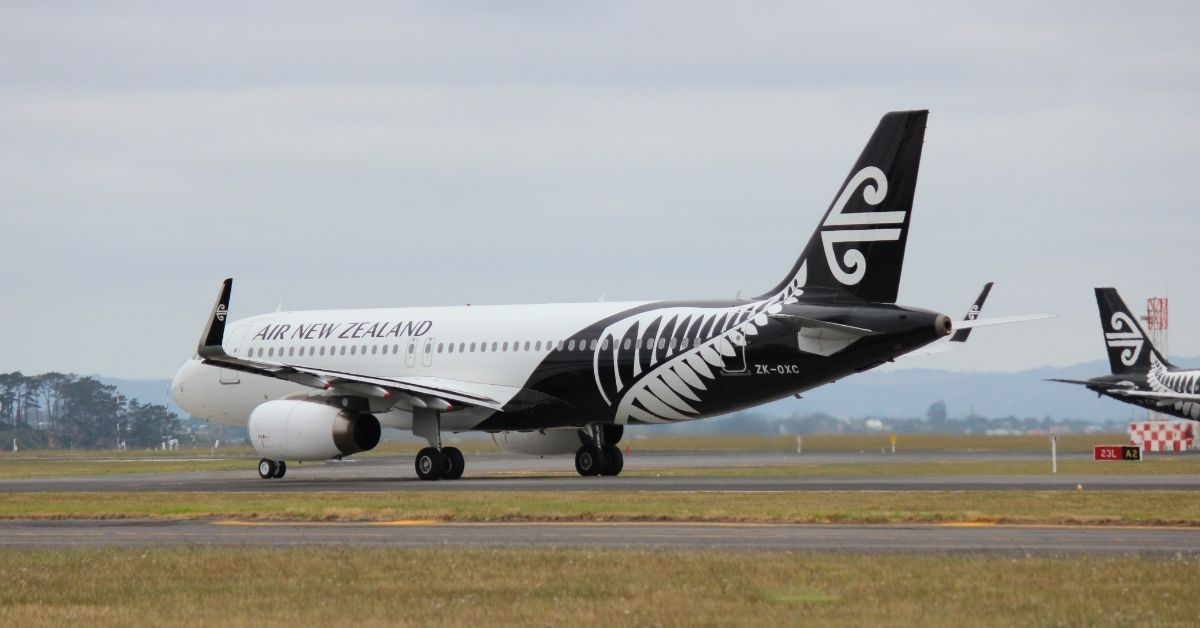 an air new zealand plane on a tarmac