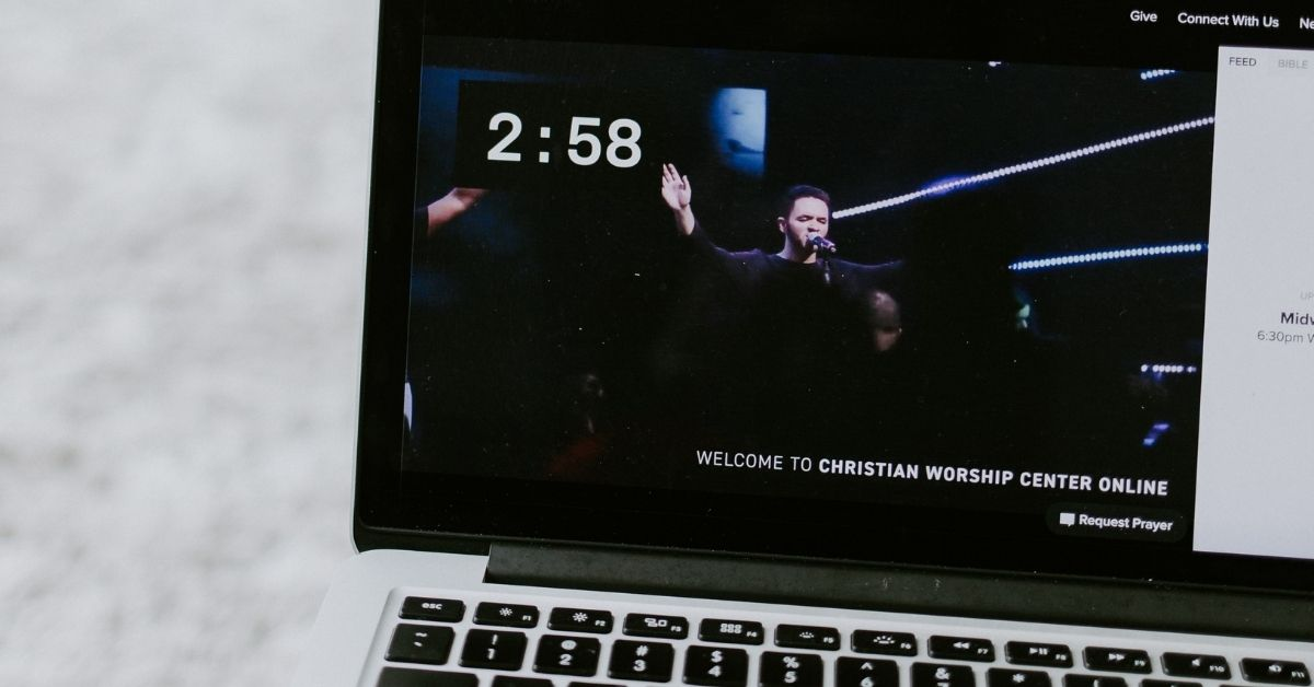 a worship service streaming on a laptop