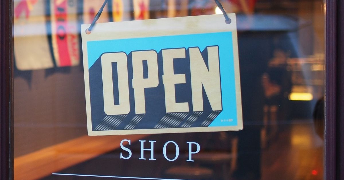 an open sign on a shop front