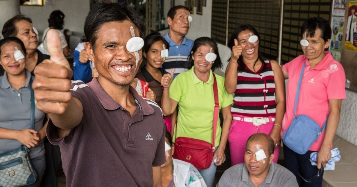 Raul, a farmer from Bacolod in the Philippines, with a group of people who now have restored sight after receiving cataract surgeries