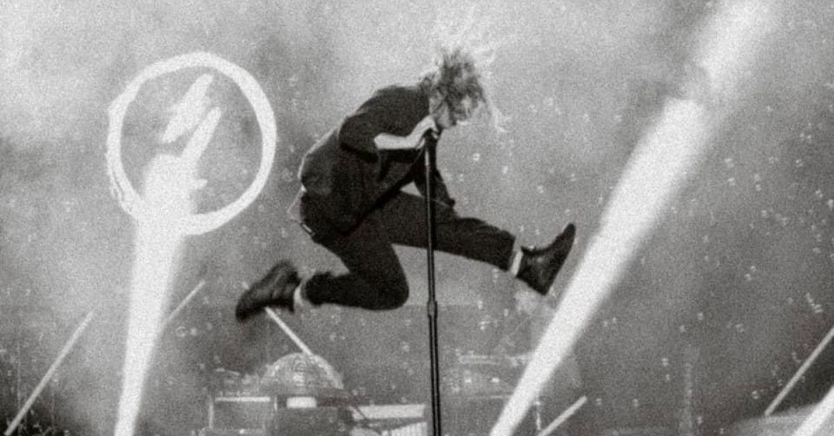 black and white shot of switchfoot vocalist jumping