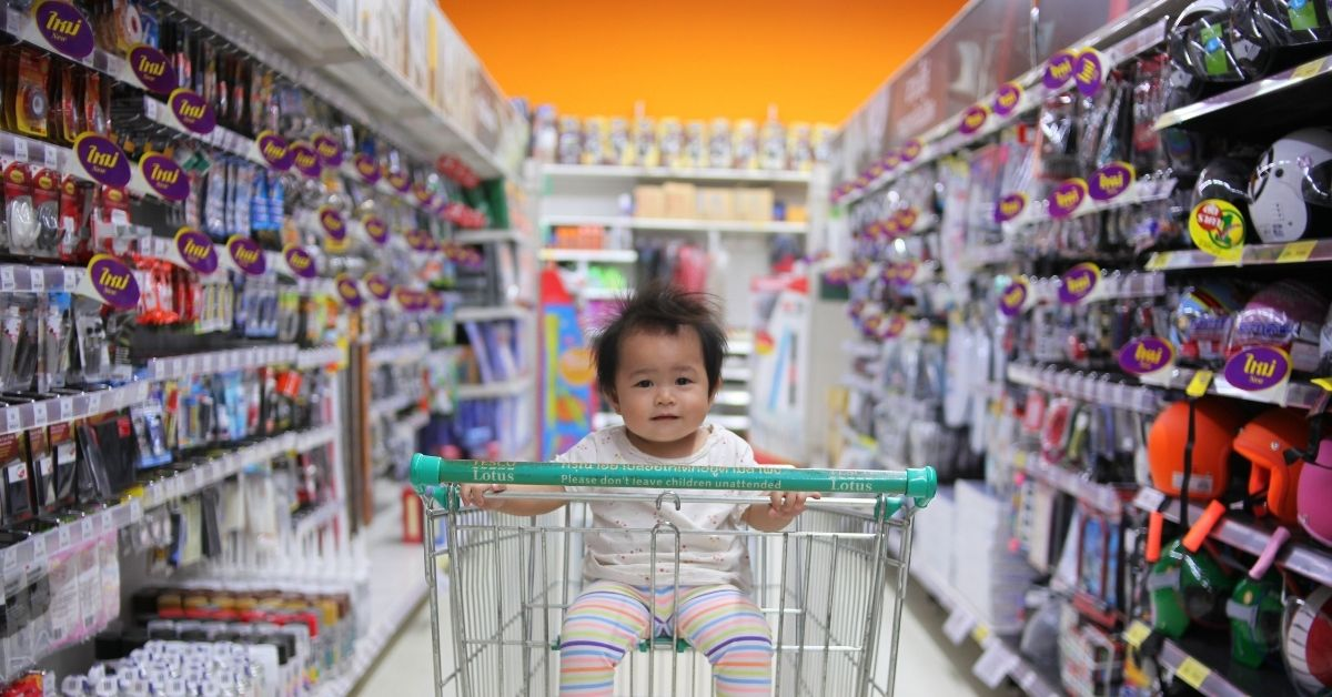 a child sits in a trolley
