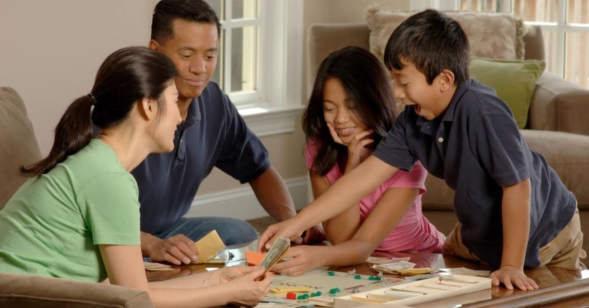 a family playing a game of monopoly