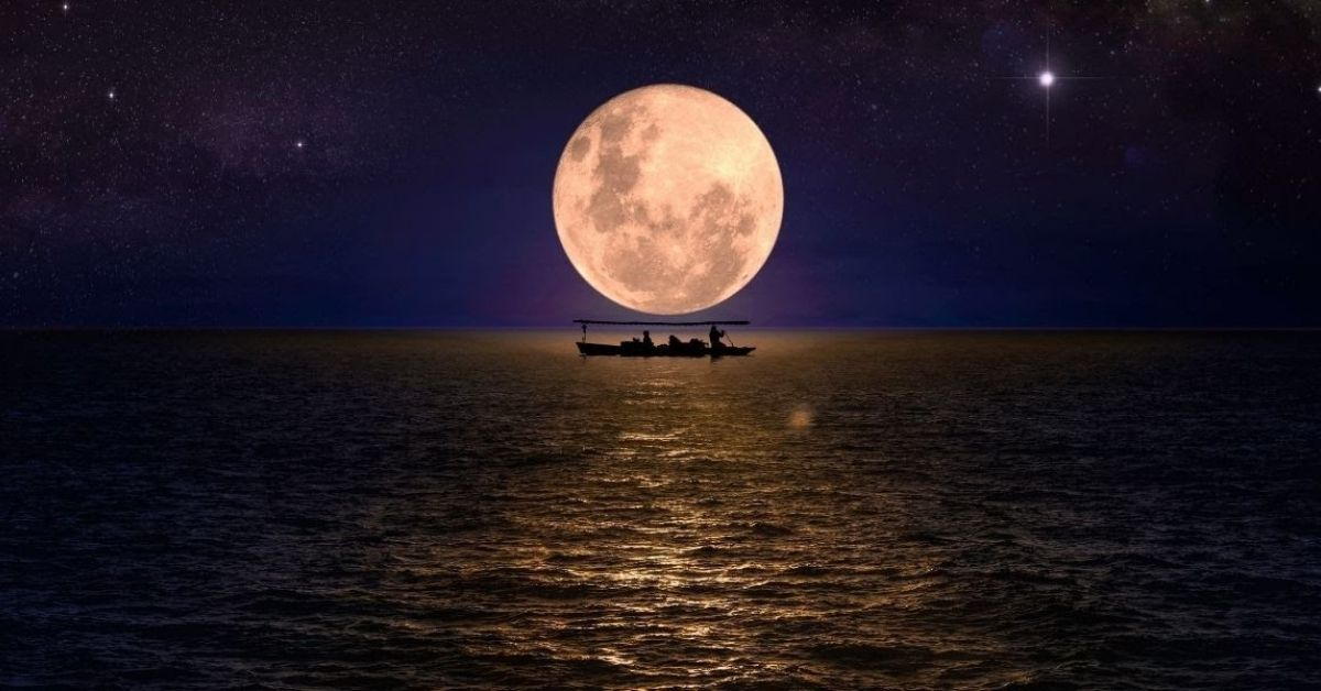 a small boat on the dark seas lit by a full moon