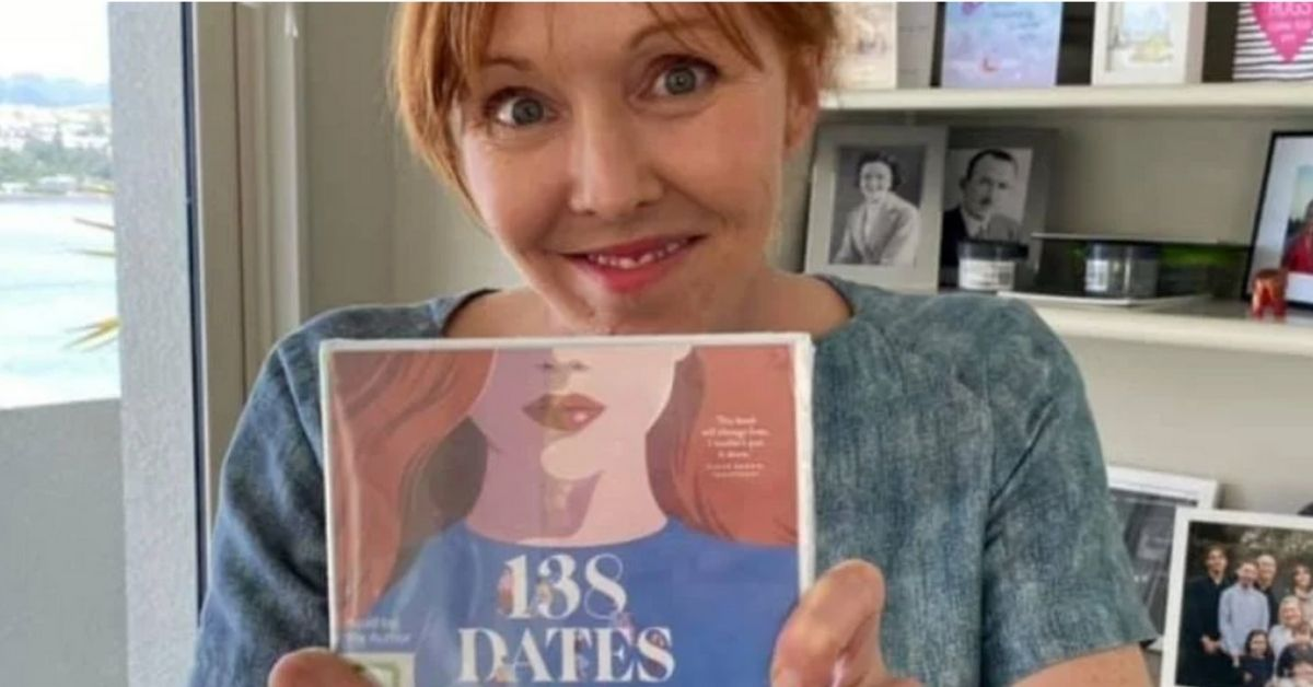 rebekah campbell holds a copy of her book 138 dates