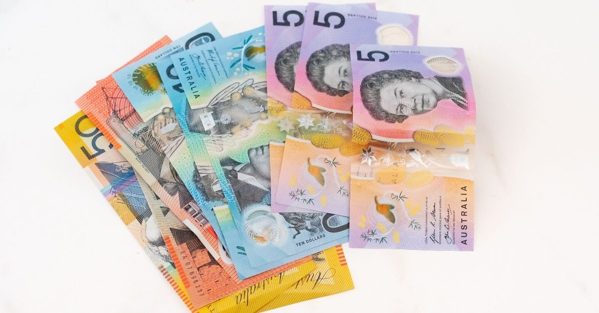 australian notes splayed out on a white table