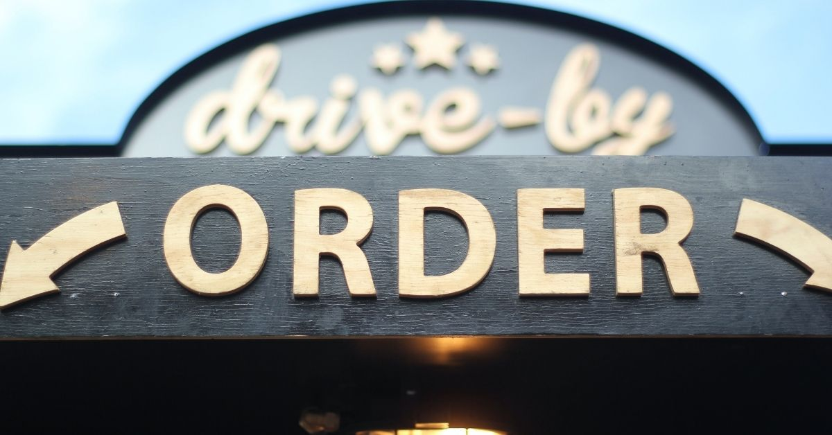 drive-thru sign stating where to order