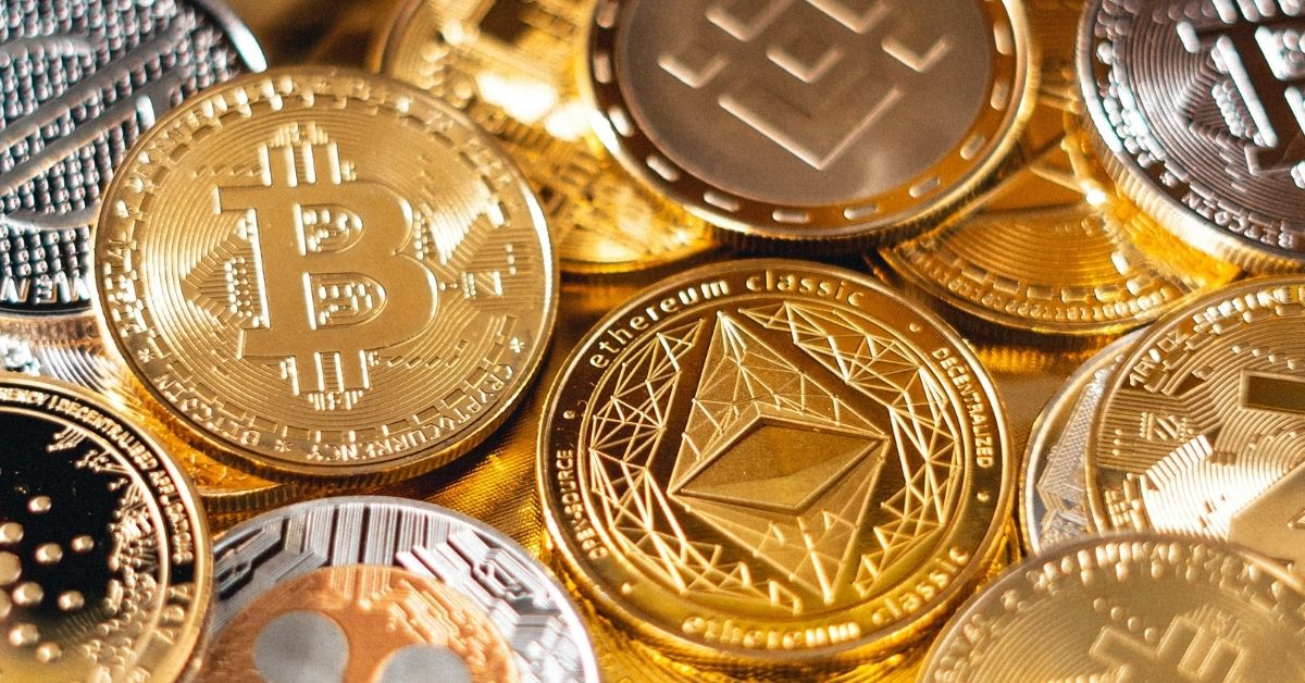 a pile of gold and silver coins representing different cryptocurrency